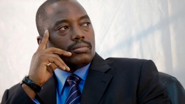 President Kabila looks on during signature ceremonies.